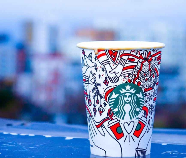 close up photo of white and red starbucks disposable cup